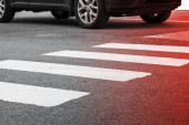 Pedestrian crossing road marking and moving car — Stock Photo