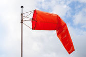 Windsock. Red wind indicator over cloudy sky — Stock Photo