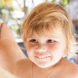 Portrait of cute blond smiling Caucasian baby girl — Stock Photo #72831519