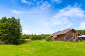 Russian rural landscape with old wooden barns — Stock Photo