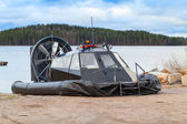 Black modern hovercraft is laying on the coast — Stock Photo