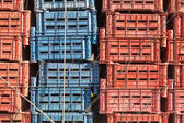 Empty plastic cargo boxes are stacked — Stock Photo