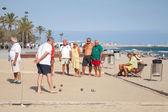 Seniors Spaniards play Bocce on a sandy beach — Stock Photo
