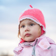 Cute Caucasian blond baby girl in pink hat — Stock Photo #76006223