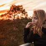 Caucasian blond girl with evening sunlight — Stock Photo #76006507