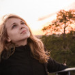 Teenage blond girl with evening sunlight — Stock Photo #76006513