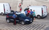 Italian policemen check documents of men — Stock Photo