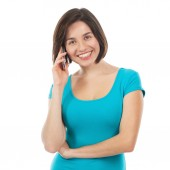 Young brunette talking on the phone — Stock Photo