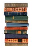 Grande pila di antiquariato di vecchi libri isolati su sfondo bianco — Foto Stock