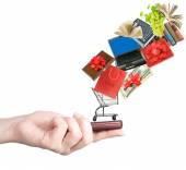 Modern mobile phone in the hand with lots of goods isolated on white — Stock Photo