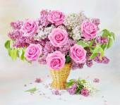 Still life with huge bunch of roses, lilac flowers and lily of the valley flowers on painting background — Stock Photo