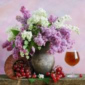 Still life with lilac, grapes and red wine on painting background — Stock Photo