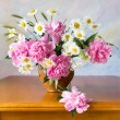Still life with peonies and chamomiles on painting background — Stock Photo #63370087