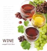 Red, white and rosy wine and grapes with fresh leaves isolated on white background with sample text — Stock Photo