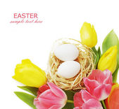 Easter eggs and tulips flower bunch isolated on white background — Stock Photo