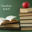 World Teacher's Day (still life with book pile, apple, globe and desk on artistic background) — Stock Photo #64142875