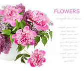 Huge bunch of pink peonies and lilac in vase isolated on white with sample text — Stock Photo