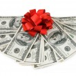 Money gift (big stack of dollars with red bow isolated on white background) — Stock Photo #64307783