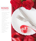 Roses bunch and table place setting with romantic decorations isolated on white background with sample text. Love, harmony and Valentine's day concept — Stock Photo