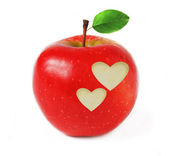 Red apple with two hearts and green leaf isolated on white background with sample text — Stock Photo