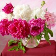 Still life with huge bunch of purple and white peonies on artistic background — Stock Photo #64681675