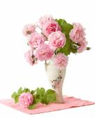 Tea roses bunch in vase isolated on white background — Stock Photo