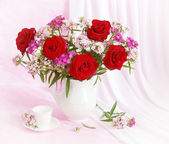 Artistic still life with red roses — Stock Photo