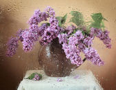 Artistic still life with bunch of lilac flowers and water drops — Stock Photo