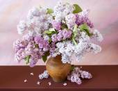 Still life with huge bunch of lilac and lily of the valley flowers on painting background — Zdjęcie stockowe
