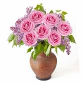 Lilac and roses bunch in vase isolated on white background — Stock Photo