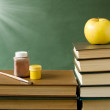 World Teacher's Day (still life with book pile, apple, globe and desk on artistic background) — Stock Photo #69814263
