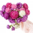 Still life with huge bunch of roses and asters and fruits — Stock Photo #69814939