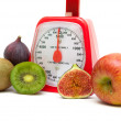 Ripe fruits and kitchen scales isolated close up on white backgr — Stock Photo #57167643