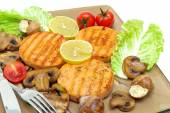 Roasted salmon medallions with mushrooms and vegetables closeup — Stock Photo