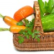 Fresh vegetables and herbs in a basket closeup on a white backgr — Stock Photo #62430237