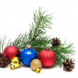 Christmas toys, pine cones and pine branches on a white backgrou — Stock Photo #64755081