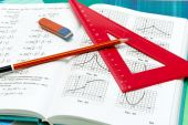 School supplies and textbooks on mathematics close up — Stock Photo