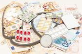 Health medications and money — Stock Photo