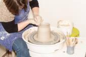 Female Potter creating a earthen jar — Stock Photo