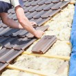 Roofer laying tile on the roof — Stock Photo #72874817