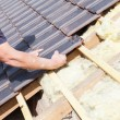 Roofer laying tile on the roof — Stock Photo #72874603