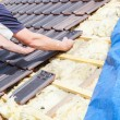 Roofer laying tile on the roof — Stock Photo #72874649