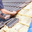 Roofer laying tile on the roof — Stock Photo #72874701