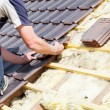 Roofer laying tile on the roof — Stock Photo #72874877