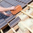 Roofer laying tile on the roof — Stock Photo #72874921