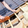 Roofer laying tile on the roof — Stock Photo #72874987