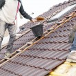Roofer laying tile on the roof — Stock Photo #72875035