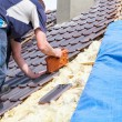 Roofer laying tile on the roof — Stock Photo #72875085