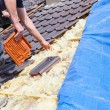 Roofer laying tile on the roof — Stock Photo #72875167
