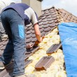 Roofer laying tile on the roof — Stock Photo #72875297